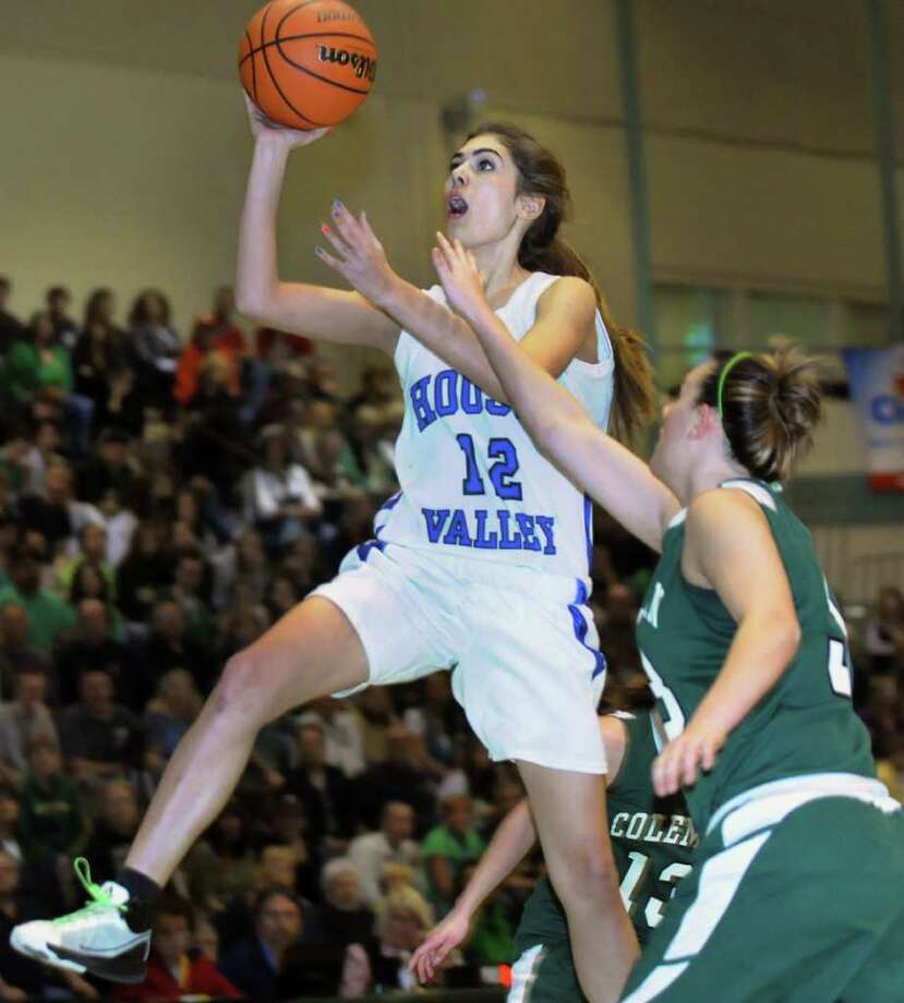 Hoosic Valley's Morgan anderson (12), center, shoots for the hoop during their Class C girls' basketball state semifinal against Coleman Catholic on Saturday, March 17, 2012, at Hudson Valley Community College in Troy, N.Y. (Cindy Schultz / Times Union) Photo: Cindy Schultz / 00016824A