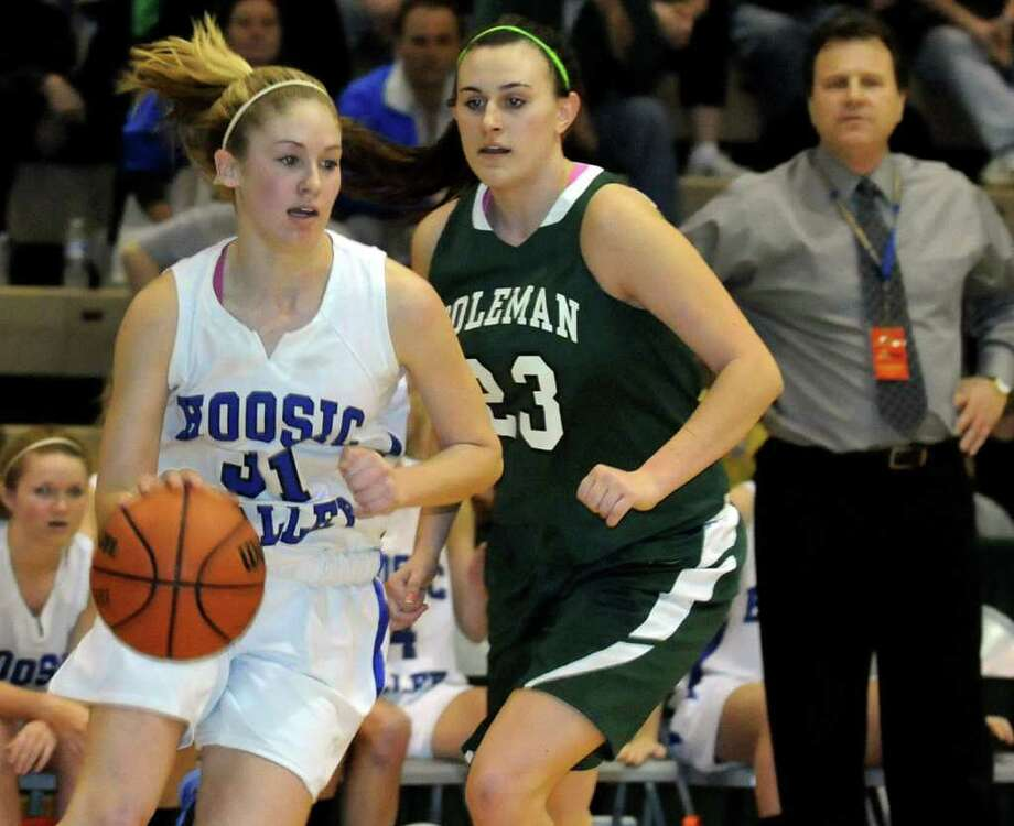 Hoosic Valley's Kim Kocienski (31), left, controls the ball as Coleman Catholic's Nicole Curley (23) defends during their Class C girls' basketball state semifinal on Saturday, March 17, 2012, at Hudson Valley Community College in Troy, N.Y. (Cindy Schultz / Times Union) Photo: Cindy Schultz / 00016824A