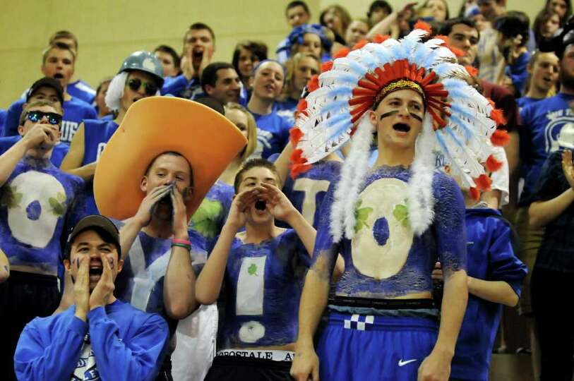Hoosic Valley's student section cheers during their Class C girls' basketball state semifinal agains