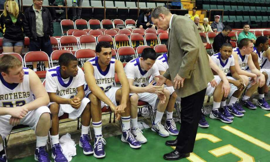 CBA coach Dave Doemel shakes hands with his players after their loss to Mount Vernon in the Class AA boys' basketball semifinal game at the Glens Falls Civic Center Saturday March 17, 2012.    (John Carl D'Annibale / Times Union) Photo: John Carl D'Annibale / 00016823A
