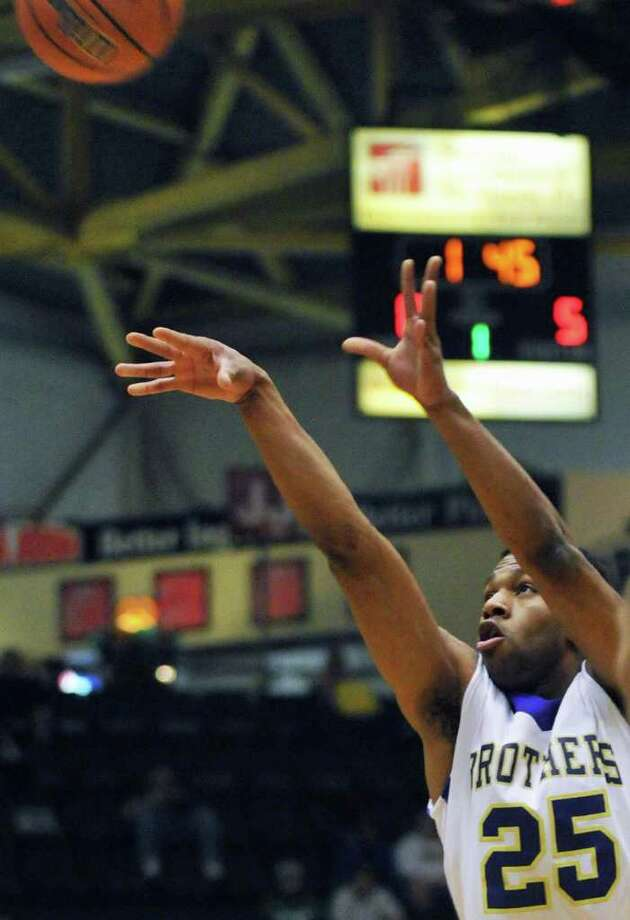 CBA's #25 Earl Ricketts shoots against Mount Vernon  in the Class AA boys' basketball semifinal game at the Glens Falls Civic Center Saturday March 17, 2012.    (John Carl D'Annibale / Times Union) Photo: John Carl D'Annibale / 00016823A