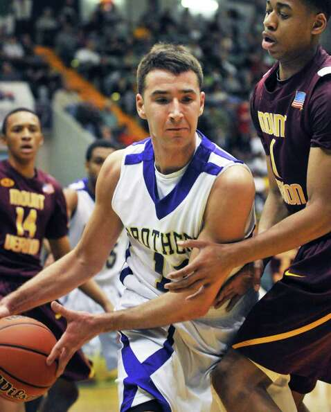 CBA's #15 Joe Krong, left, and Mount Vernon's Randy Stephens during the Class AA boys' basketball se