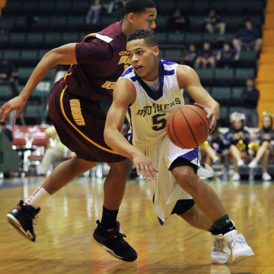 CBA's #5 Christian Leppanen, at right, dribbles past a Mount Vernon defender in the Class AA boys' basketball semifinal game at the Glens Falls Civic Center Saturday March 17, 2012.    (John Carl D'Annibale / Times Union) Photo: John Carl D'Annibale / 00016823A