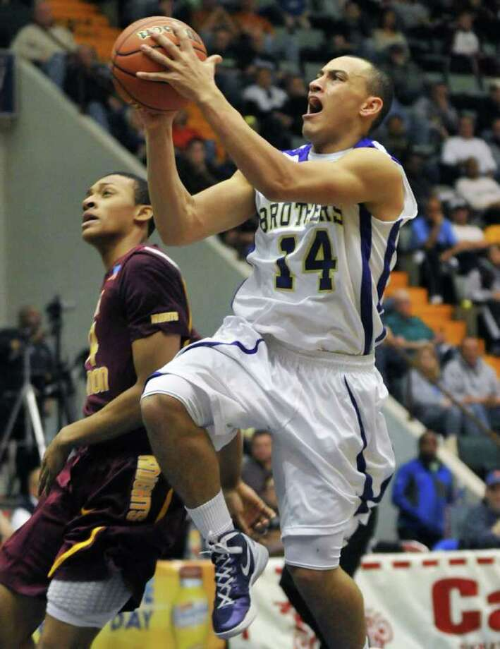 CBA's #14 Chaz Lott scores against Mount Vernon  in the Class AA boys' basketball semifinal game at the Glens Falls Civic Center Saturday March 17, 2012.    (John Carl D'Annibale / Times Union) Photo: John Carl D'Annibale / 00016823A