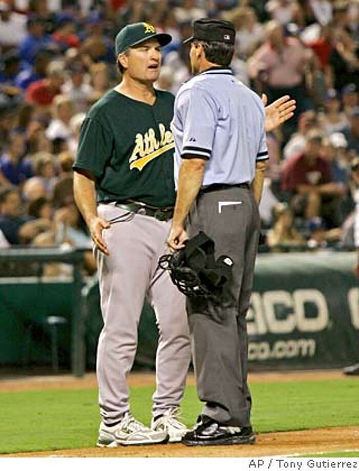 Oakland Athletics manager Bob Geren, left, argues with home plate umpire Angel Hernandez, right, following a close play at third in the fourth inning of a baseball game against the Texas Rangers in Arlington, Texas, Saturday, Sept. 8, 2007.(AP Photo/Tony Gutierrez) Photo: Tony Gutierrez