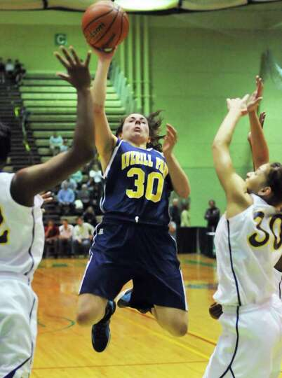 Averill Park's #30 Elaina Ryan, center, goes to the basket in the state Class A girls' basketball fi