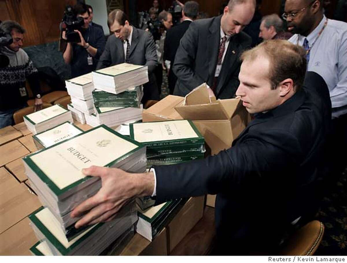 Copies of U.S. President George W. Bush's 2007 budget are delivered to the Senate Budget Committee hearing room on Capitol Hill in Washington February 6, 2006. Bush's fiscal 2007 budget comes during a congressional election year as he faces concern and frustration among some of his Republican allies over surging deficits. REUTERS/Kevin LamarqueRan on: 02-07-2006 Copies of President Bushs proposed budget for 2006-07 are delivered to the Senate Budget Committee hearing room on Capitol Hill.