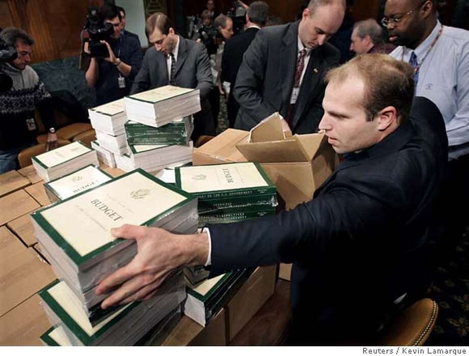 Copies of U.S. President George W. Bush's 2007 budget are delivered to the Senate Budget Committee hearing room on Capitol Hill in Washington February 6, 2006. Bush's fiscal 2007 budget comes during a congressional election year as he faces concern and frustration among some of his Republican allies over surging deficits. REUTERS/Kevin LamarqueRan on: 02-07-2006  Copies of President Bush's proposed budget for 2006-07 are delivered to the Senate Budget Committee hearing room on Capitol Hill. Photo: KEVIN LAMARQUE