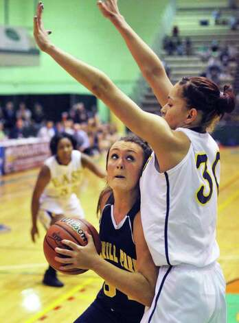 Averill Park's #34 Bridget Carney looks for a way around East High's #30 Rose Ayala, at right, during the state Class A girls' basketball final int the McDonough Complex at HVCC un Troy Saturday March 17, 2012.   (John Carl D'Annibale / Times Union) Photo: John Carl D'Annibale / 00016825A