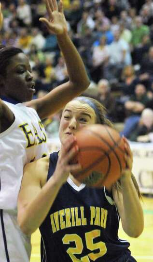 Averill Park's #25 Brooke O'Shea gets under East High's #10 Taylor Hosbey, at left, during the state