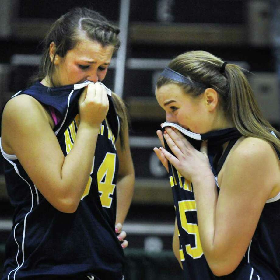 Averill Park's #34 Bridget Carney, left, and #25 Brooke O'Shea react after losing the state Class A girls' basketball final to east High at HVCC in Troy Saturday March 17, 2012.   (John Carl D'Annibale / Times Union) Photo: John Carl D'Annibale / 00016825A