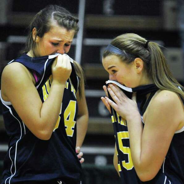 Averill Park's #34 Bridget Carney, left, and #25 Brooke O'Shea react after losing the state Class A