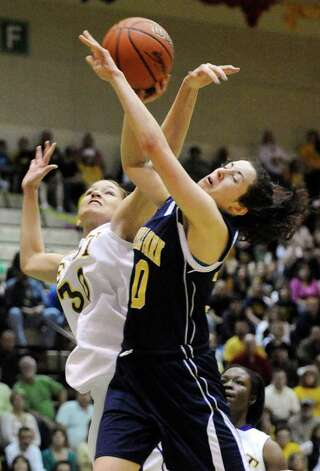 East's Rose Ayala, left, and Averill Park's Elaina Ryan, right, fight for a rebound in the New York State Girls Basketball Championship Class A final in Troy, N.Y. on Saturday, March 17, 2012. (AP Photo/Tim Roske) Photo: Tim Roske