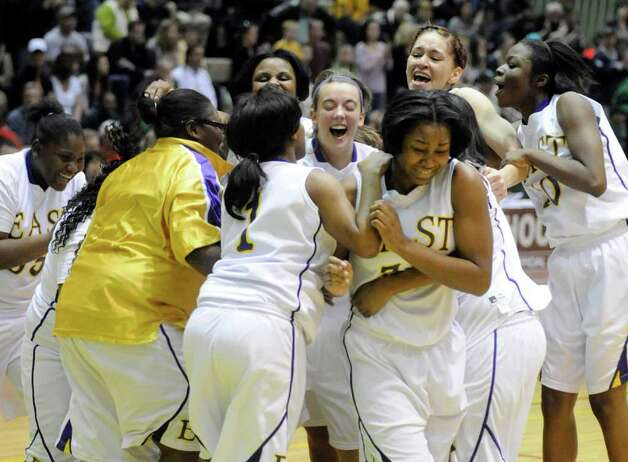 East players celebrate their win over Averill Park in the New York state girls basketball championship class A final in Troy, N.Y. on Saturday, March 17, 2012.  (AP Photo/Tim Roske) Photo: Tim Roske