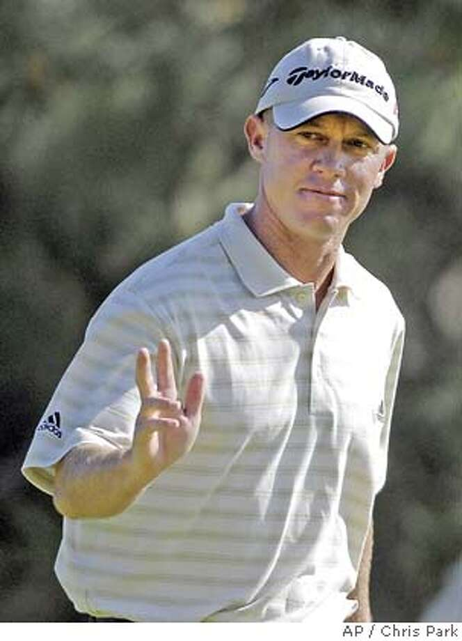 Nathan Green, of Australia, acknowledges the applause after his birdie on the 12th hole during the third round of the Buick Invitational golf tournament Saturday, Jan. 28, 2006 in San Diego. Green finished at 10-under-par and is one stroke off the lead. (AP Photo/Chris Park) **EFE OUT** Photo: CHRIS PARK