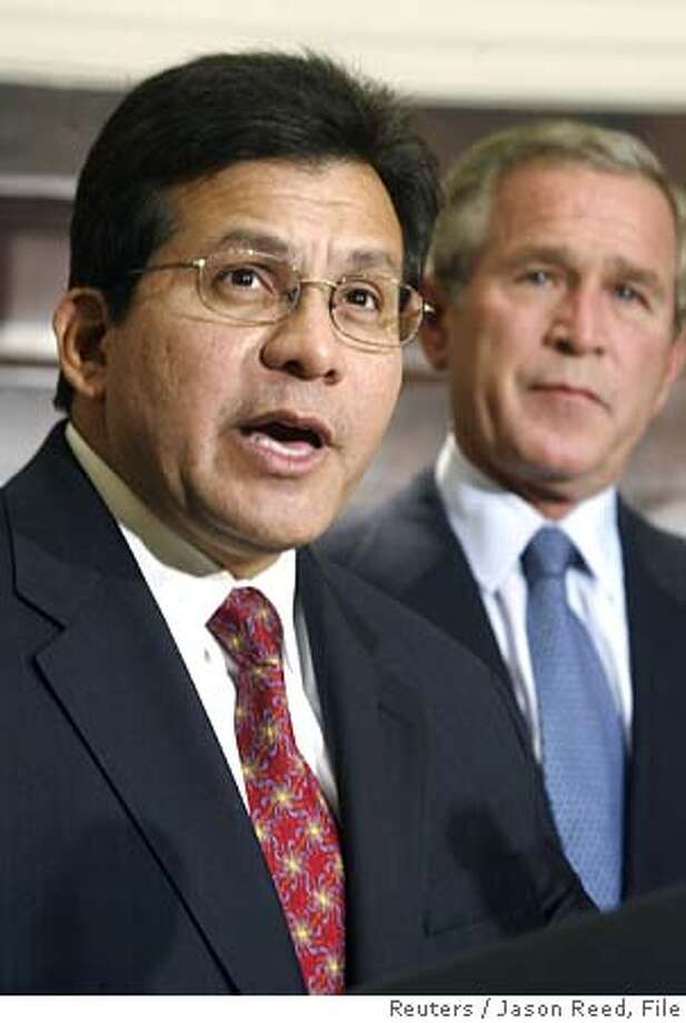 U.S. President George W. Bush listens as White House legal counsel Alberto Gonzales speaks to the press, after Bush nominated him the new attorney general, in the Roosevelt Room of the White House in Washington, November 10, 2004. If confirmed by the Republican-controlled Senate, Gonzales, 49, would be the first Hispanic-American to become the country's top law-enforcement official. He would replace Attorney General John Ashcroft, whose resignation was announced November 9. REUTERS/Jason Reed Ran on: 11-14-2004  Alberto Gonzales will be the nation's first Hispanic attorney general if he is confirmed. Ran on: 11-14-2004  Alberto Gonzales will be the nation's first Hispanic attorney general if he is confirmed. 0 Photo: JASON REED