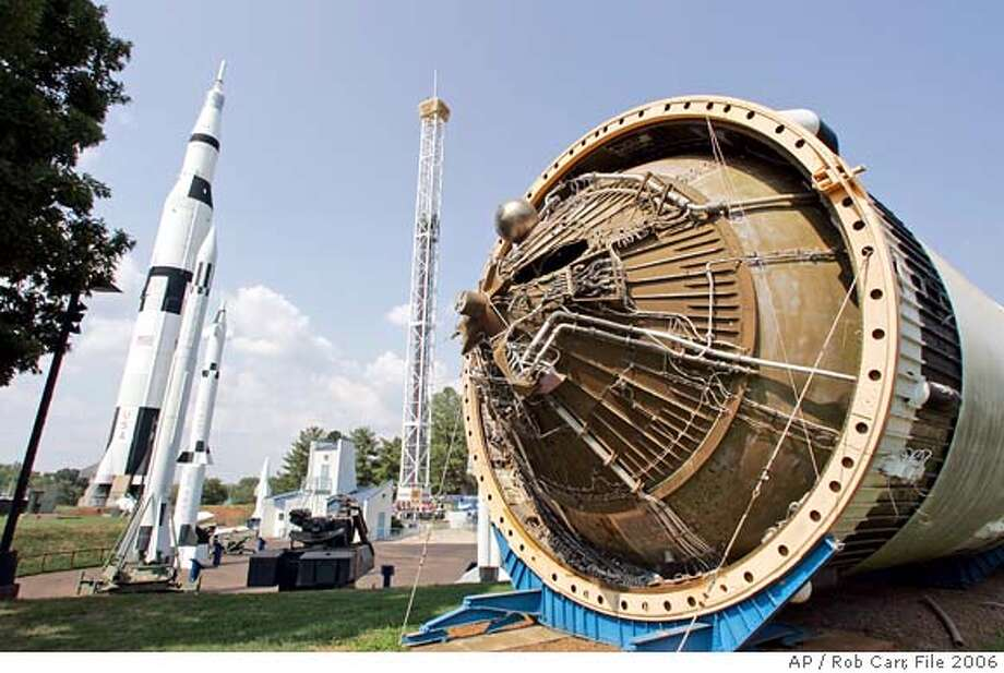 ** ADVANCE FOR MONDAY AUG. 14 ** NASA engineers designing the new Ares moon rocket have taken parts off an old Saturn S4B rocket stage, right, shown on display at the U.S. Space and Rocket Center Wednesday, Aug. 2, 2006 in Huntsville, Ala.The space agency is using ideas and pieces from its past to develop the next U.S. lunar rocket. (AP Photo/Rob Carr)  Ran on: 08-20-2006  NASA engineers designing the Ares rocket have taken parts from an old Saturn rocket stage (right) on display in Huntsville, Ala.  Ran on: 09-09-2007  Owen Garriott Photo: ROB CARR