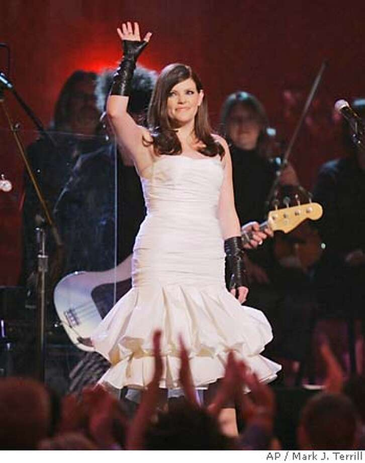 "Natalie Maines and The Dixie Chicks perform the song ""Not Ready to Make Nice"" at the 49th Annual Grammy Awards on Sunday, Feb. 11, 2007, in Los Angeles. (AP Photo/Mark J. Terrill)  Ran on: 02-16-2007  Dixie Chicks (from left) Emily Robison, Natalie Maines and Martie Maguire bask in the glow of their Grammy victories, which came despite being shut out by country radio after Maines' 2003 remark about President Bush and the then-pending invasion of Iraq. Photo: Mark J. Terrill"