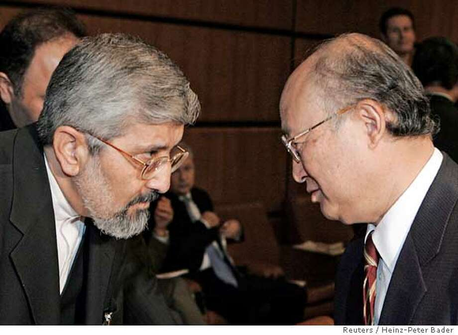 Iran's ambassador to the International Atomic Energy Agency (IAEA) Aliasghar Soltaniyeh (L) talks with the chairman of the IAEA board of governors, Yukiya Amano, at the beginning of the board of governors meeting in the U.N. nuclear watchdog's Vienna headquarters February 4, 2006. The board of governors voted on Saturday to report Iran to the U.N. Security Council over concerns Tehran is secretly seeking atomic weapons, a diplomat said. REUTERS/Heinz-Peter BaderRan on: 02-05-2006  Iran's ambassador to the IAEA, Ali Asghar Soltanieh (left), talks to Yukiya Amano, chairman of the agency's board of governors. Photo: HEINZ-PETER BADER