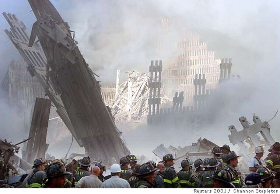 A group of firefighters stand in the street near the destroyed World Trade Center in New York on September 11, 2001. Two hijacked U.S. commercial planes slammed into the twin towers of the World Trade Center on Tuesday, causing both 110-story landmarks to collapse in thunderous clouds of fire and smoke. REUTERS/Shannon Stapleton  Ran on: 09-09-2007 Ran on: 09-09-2007  Six years ago, America was shocked at the destruction of the World Trade Center towers, the remains of which are show here. The country has now changed, especially in regard to law enforcement. Photo: SHANNON STAPLETON