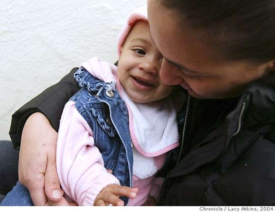 "Gina Balestrieri with one of her children Leila, 9 months outside their home, Tuesday Feb.24,2004,in San Francisco. Gina was beaten by an officer of the SFPD in 1997.Gina DIDN""T want to be recognized in photo.  Event on 2/24/04 in SAN FRANCISCO. LACY ATKINS / The Chronicle Photo: LACY ATKINS"