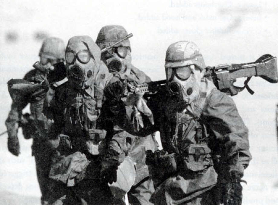 "U.S. soldiers undergo chemical defense training in eastern Saudi Arabia before the start of Operation Desert Storm against Iraq in 1991. Associated Press file photo, 1990, from ""War of Nerves"""