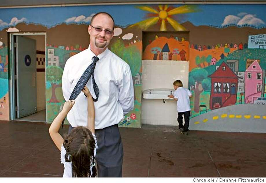 nevius09_038_df.jpg  First-grader Lia Pickholtz plays with Rosenberg's tie. Chris Rosenberg is the principal of Starr King Elementary School and spoke about race in schools. Photographed in San Francisco on 9/7/07. Deanne Fitzmaurice / The Chronicle Ran on: 09-09-2007  Principal Chris Rosenberg of Starr King Elementary, with student Lia Pickholtz, says &quo;no one wants to touch&quo; race issues in schools. Photo: Deanne Fitzmaurice