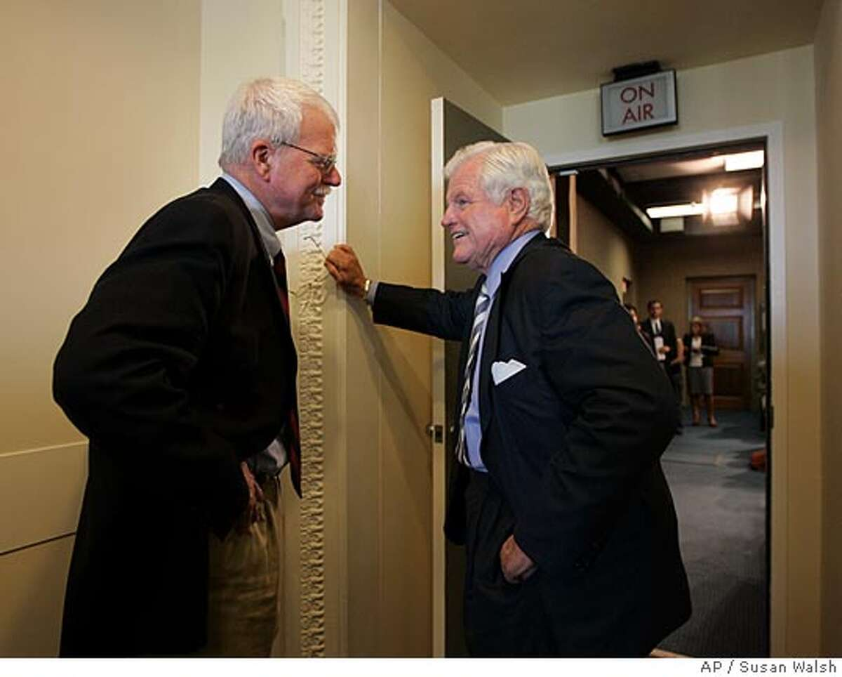 Sen. Edward Kennedy, D-Mass., right, talks with Rep. George Miller, D-Calif., on Capitol Hill in Washington, Friday, Sept. 7, 2007, prior a news conference on higher education. (AP Photo/Susan Walsh)
