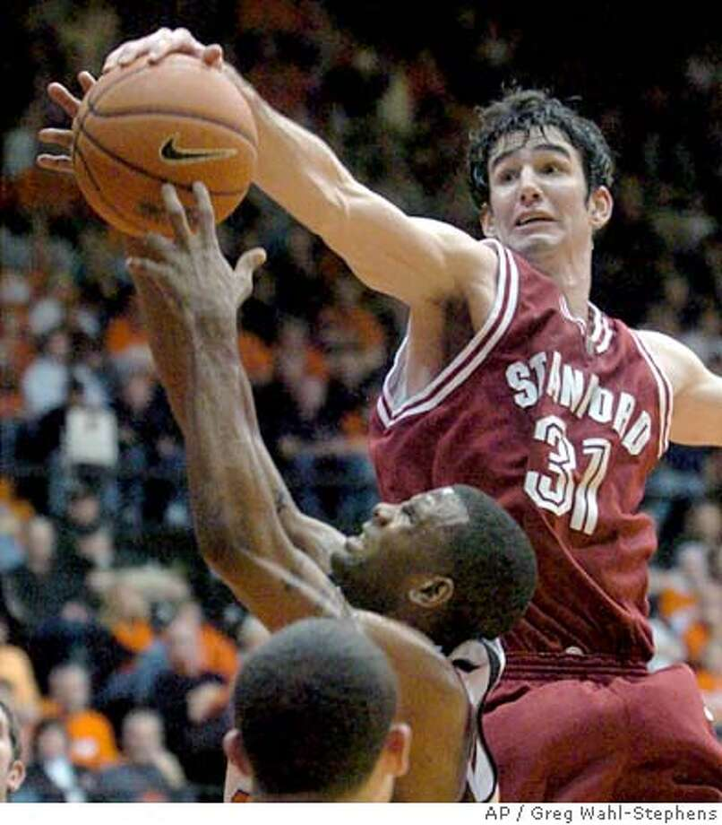 Stanford's Taj Finger, top right, blocks a shot by Oregon State's Wesley Washington, during the second half of a college basketball game in Corvallis, Ore., Saturday Feb. 4, 2006. Stanford won 71-64. (AP Photo/Greg Wahl-Stephens) Photo: GREG WAHL-STEPHENS