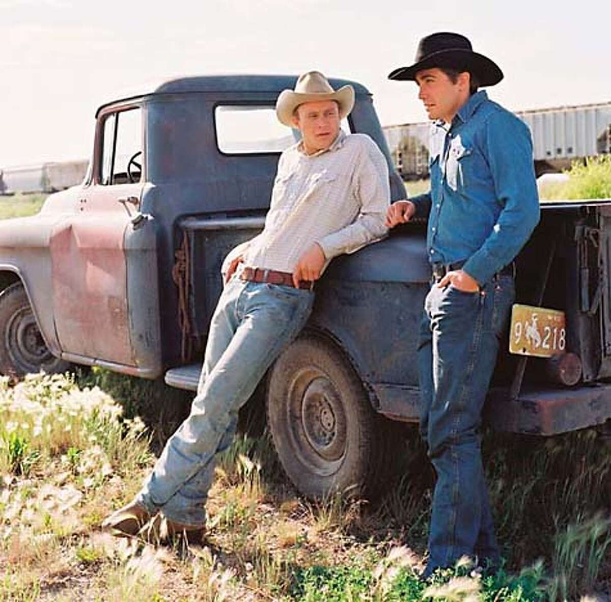 """**FILE**This photo provided by Focus Features, shows actors Heath Ledger, left, and Jake Gyllenhaal, who play two cowboys from very different backgrounds who meet and fall in love, in a scene from """"Brokeback Mountain."""" The film is among a wave of Oscar contenders that marked a year of Hollywood political and social activism. (AP Photo/ Focus Features/ Kimberly French) UNDATED HANDOUT PROVIDED BY FOCUS FEATURES."""