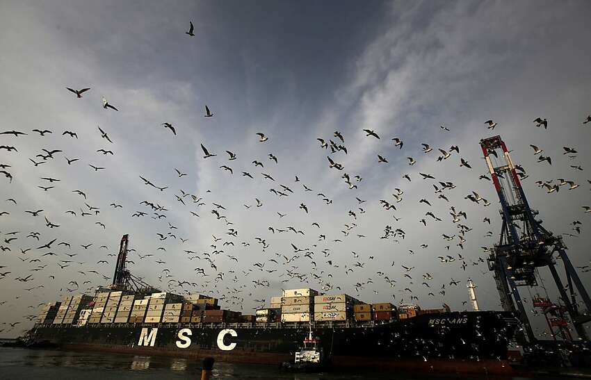 Birds fly above a freighter as it is towed to the docks at the APM Terminals BV area of the Port of Callao in Lima, Peru, on Thursday, March 15, 2012. Economic activity in Peru expanded 5.4 percent from a year earlier, compared with 6 percent growth in December, the government's statistics agency said today in an e-mailed report. Photographer: Dado Galdieri/Bloomberg