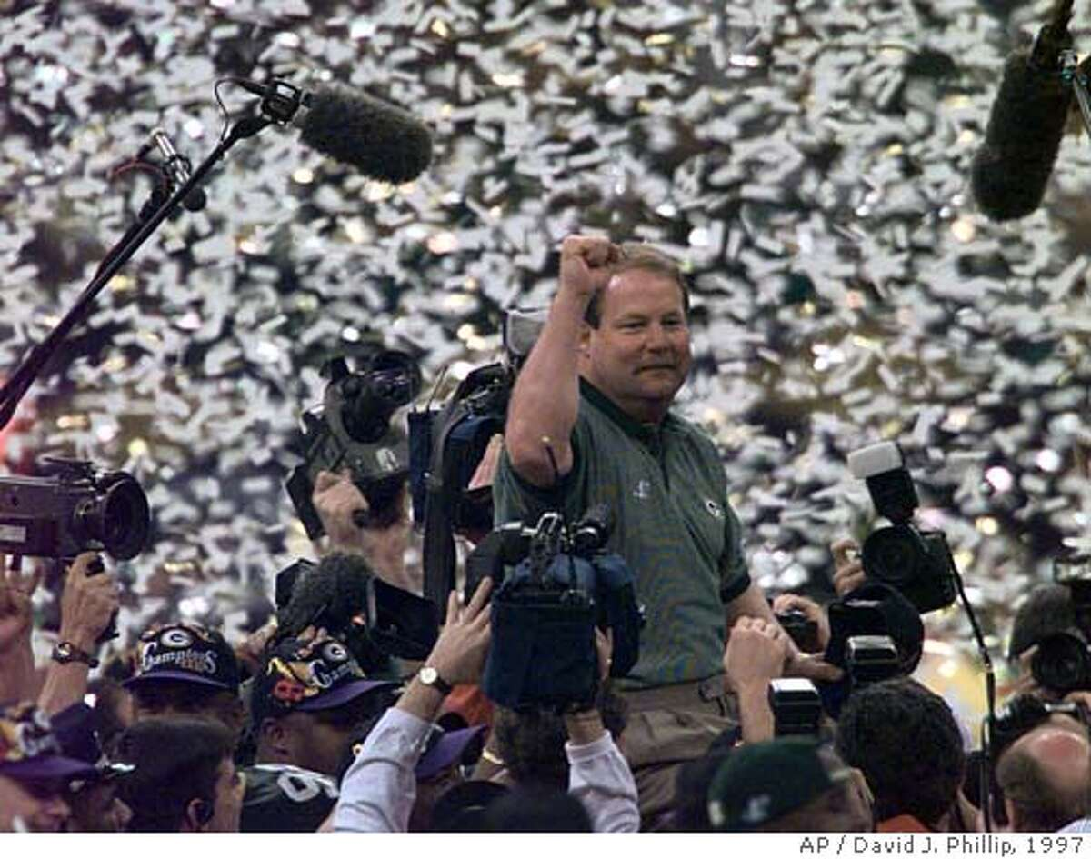 �Green Bay Packers head coach Mike Holmgren is carried off the field after his team won Super Bowl XXXI 35-21 against the New England Patriots in New Orleans Sunday Jan. 26, 1997. (AP Photo/David J. Phillip) ELECTRONIC IMAGE