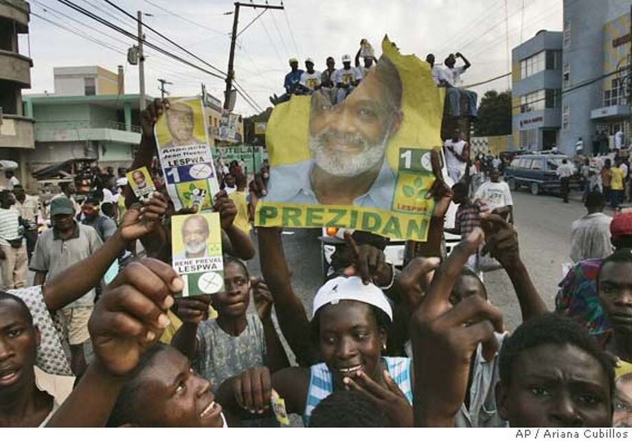 Supporters of presidential candidate Rene Preval rally through the Delmas road in Port-au-Prince, Haiti, Friday, Feb. 3, 2006. Haitians will vote Feb. 7, in the first presidential election since the ouster of former President Jean-Bertrand Aristide in February 2004. (AP Photo/Ariana Cubillos) Photo: ARIANA CUBILLOS