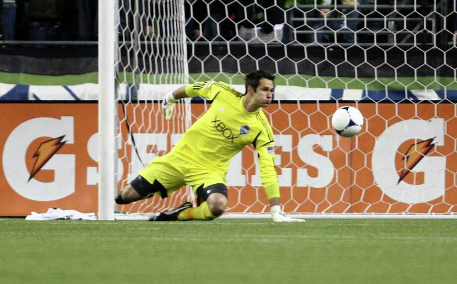 Seattle Sounders goal keeper Michael Gspurning works to keep a ball out of the goal during the MLS season opener against Toronto FC on Saturday, March 17, 2012 at CenturyLink Field in Seattle. Photo: JOSHUA TRUJILLO / SEATTLEPI.COM
