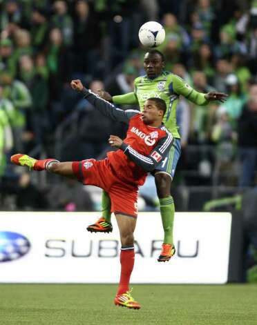 Sounders player Jhon Kennedy Hurtado goes up against Toronto FC's Ryan Johnson. Photo: JOSHUA TRUJILLO / SEATTLEPI.COM