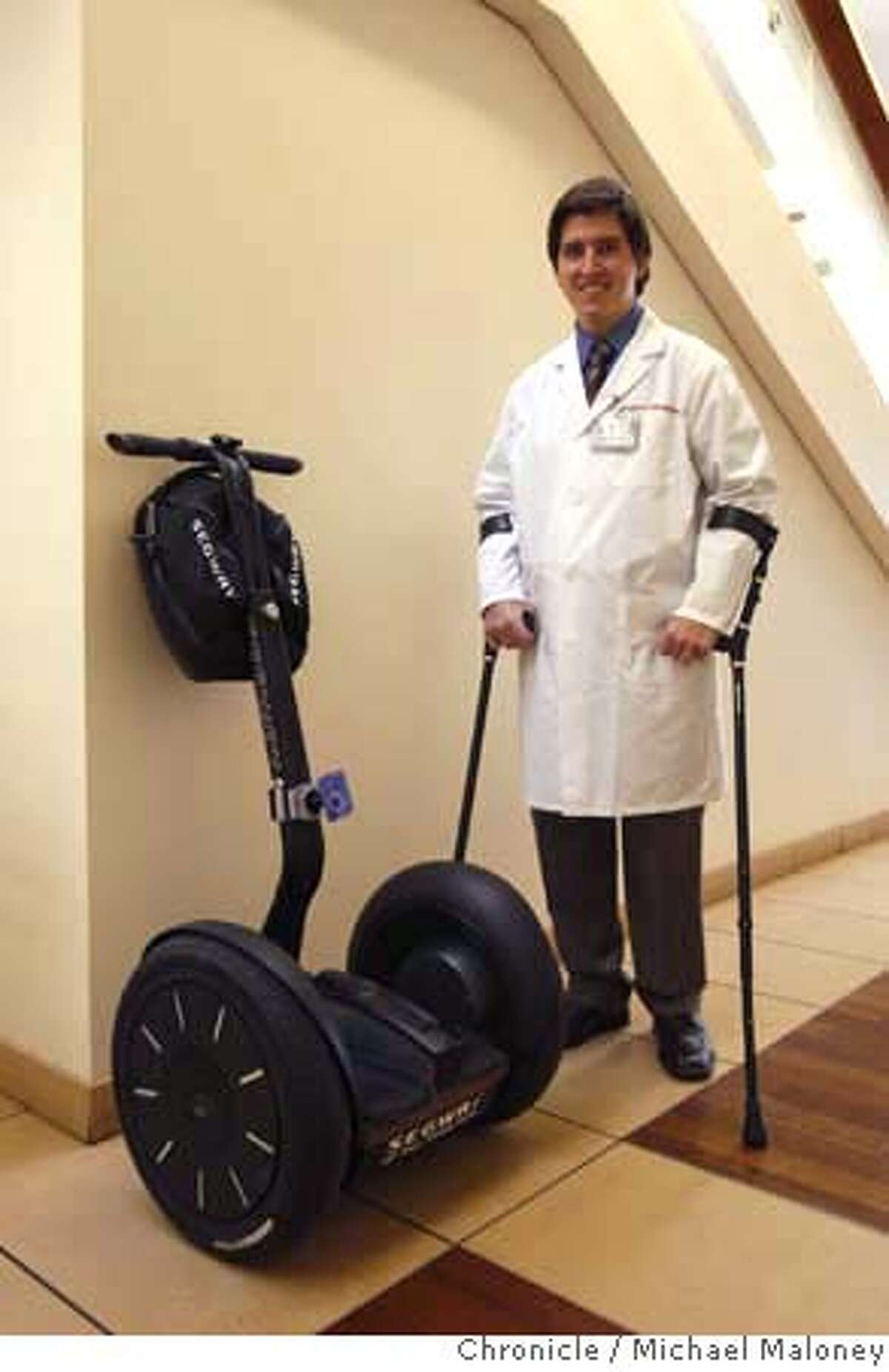 Dr. Peter D. Poullos travels the hallways of Stanford Hospital (where he works) on his battery powered Segway. Poullos was paralyzed in a cycling accident leaving him to either use crutches or a wheelchair until he discovered the Segway. Photo taken on February 11, 2008 at Stanford, CA. Photo by Michael Maloney / The Chronicle MANDATORY CREDIT FOR PHOTOG AND SAN FRANCISCO CHRONICLE/NO SALES-MAGS OUT