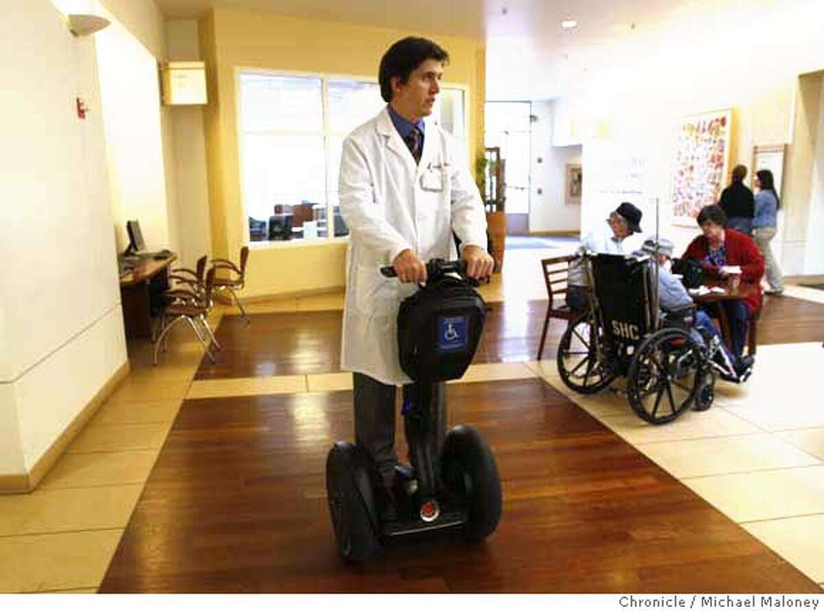 Dr. Peter D. Poullos travels the hallways of Stanford Hospital (where he works) on his battery powered Segway. Poullos was paralyzed in a cyciing accident leaving him to either use crutches or a wheelchair until he discovered the Segway. Photo taken on February 11, 2008 at Stanford, CA. Photo by Michael Maloney / The Chronicle MANDATORY CREDIT FOR PHOTOG AND SAN FRANCISCO CHRONICLE/NO SALES-MAGS OUT