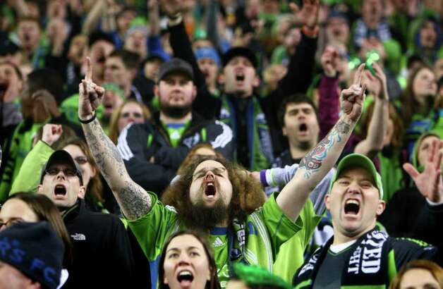 Fans celebrate during the Sounders' MLS season opener. Photo: JOSHUA TRUJILLO / SEATTLEPI.COM