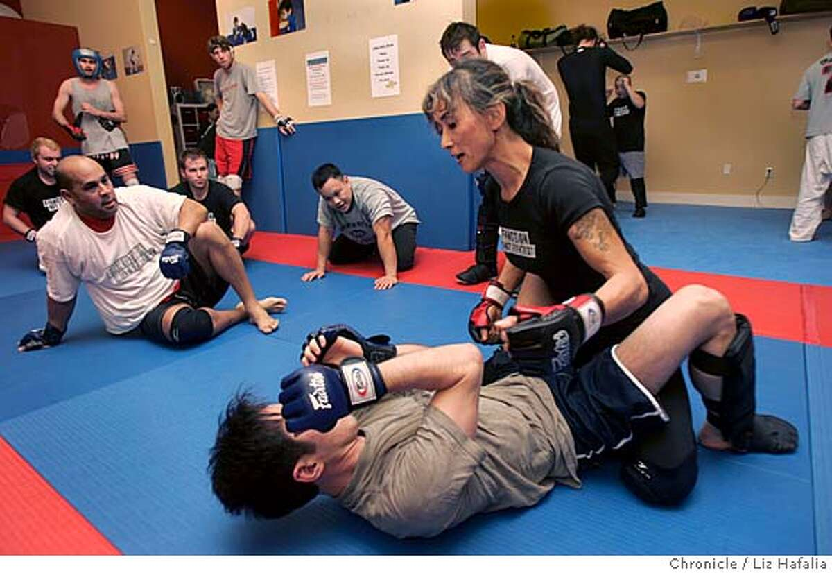 FIGHT_044_LH.JPG Instructor Lilly Tagle (middle) teaching how to hit at Modern Combatives gym. Photographed by Liz Hafalia on 1/26/06 in Berkeley, California. SFC Creditted to the San Francisco Chronicle/ LIZ HAFALIA