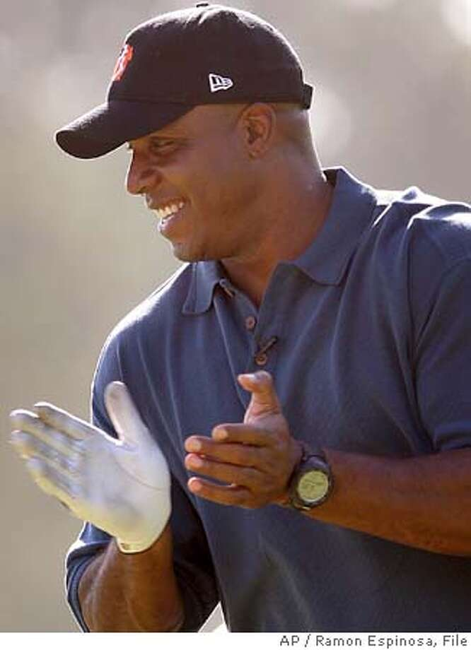 San Francisco Giants baseball team outfielder Barry Bonds claps during the 20th annual Juan Marichal Golf Classic in Juan Dolio, Dominican Republic, Saturday Jan. 21, 2006. (AP Photo/Ramon Espinosa) ***EFE OUT*** Photo: RAMON ESPINOSA