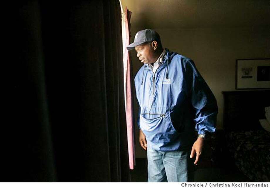 CHRISTINA KOCI HERNANDEZ/CHRONICLE  Photos of Obiedee Zackery, Katrina survivor from the 9th ward, New Orleans, at his room in Jack London Inn, in Oakland. He'll soon be moving into an apartment in East Oakland. Photo: CHRISTINA KOCI HERNANDEZ