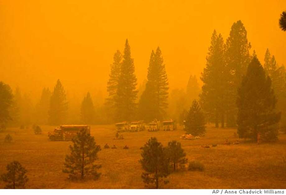 Fire crews stage east of Greenville, Calif., as evening settles Thursday, Sept. 6, 2007, onto the Moonlight fire in Plumas National Forest, which is now 28,000 acres and 8 percent contained. (AP Photo/The Bee, Anne Chadwick Williams) ** TV OUT, ONLINE OUT, MAGS OUT, NO SALES, MANDATORY CREDIT ** TV OUT, ONLINE OUT, MAGS OUT, NO SALES, MANDATORY CREDIT Photo: Anne Chadwick Williams