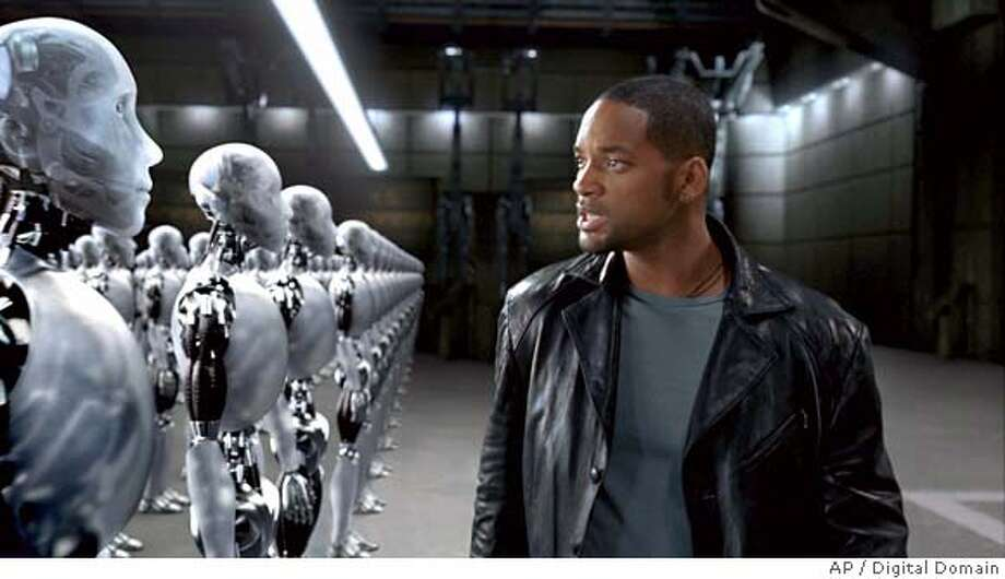 "On the hunt for a murderer, Chicago Police Detective Del Spooner (Will Smith) takes a close look at one of several thousand suspects, in ""I,Robot."" (AP Photo/Digital Domain) Ran on: 07-16-2004 Ran on: 07-16-2004 NO SALES. NO MAGAZINES Photo: DIGITAL DOMAIN"