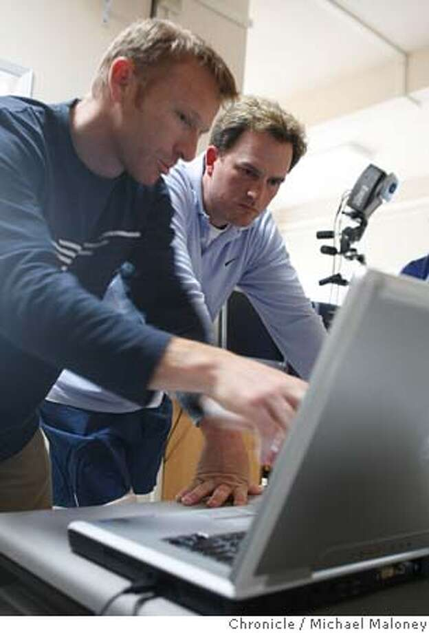 GOLFLAB_017_MJM.jpg  Thor Besier, (left) a bio mechanist (working on his post doc at Stanford) and golfer Casey Martin look over a video analysis of Martin's swing on a laptop computer.  Professional golfer Casey Martin, a Stanford alum was wired up at the Motion & Gait Lab near Packard Hospital at Stanford campus as part of the lab's quest for determining a biomechanical basis for the elusive perfect golfswing. They're also using the study to help understand how the body works in the hopes of helping people with disabilities, particularly children. Event in Stanford, CA  Photo by Michael Maloney / The San Francisco Chronicle MANDATORY CREDIT FOR PHOTOG AND SF CHRONICLE/ -MAGS OUT Photo: Michael Maloney