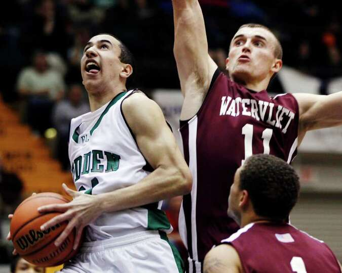 Bishop Ludden's Nick Walker takes a shot in front of Watervliet's Griffin Kelly (11) during a New Yo