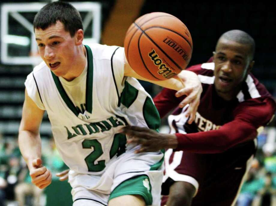 Watervliet's Tyler McLeod, right, knocks the ball away from Bishop Ludden's Matt Rogers (24) during a New York State Public High School Athletic Association boys' Class B championship basketball game in Glens Falls, N.Y., on Saturday, March 17, 2012. (AP Photo/Mike Groll) Photo: Mike Groll