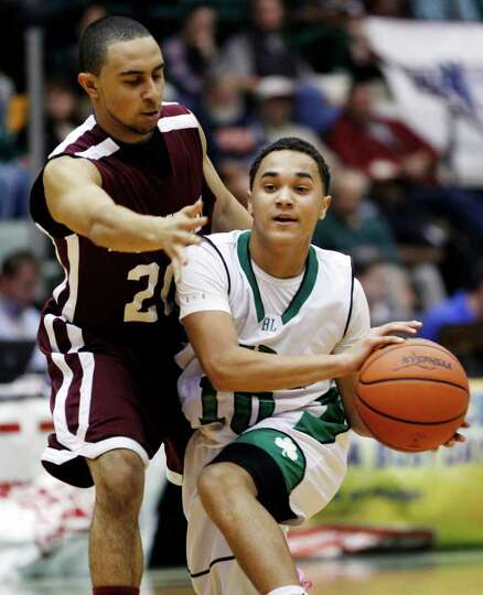 Watervliet's Jon Parker (20) guards Bishop Ludden's Cameron Littlejohn (10) during a New York State