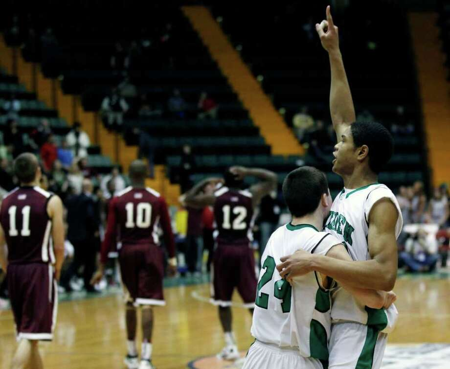 Bishop Ludden's Matt Rogers (24) and Daniel Kaigler react after their team's 43-42 win over Watervliet in a New York State Public High School Athletic Association boys' Class B championship basketball game in Glens Falls, N.Y., on Saturday, March 17, 2012. (AP Photo/Mike Groll) Photo: Mike Groll