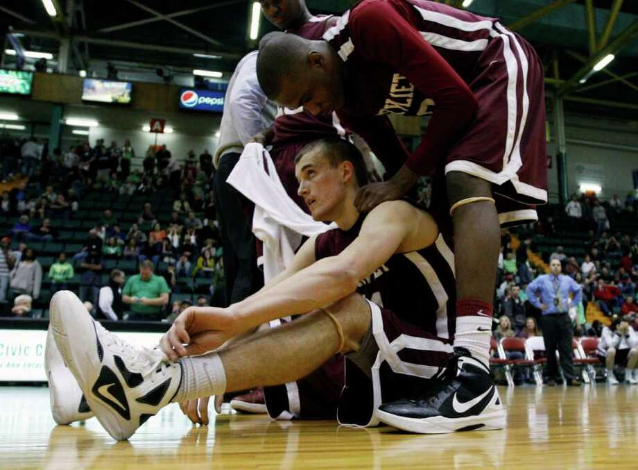 Watervliet's Griffin Kelly, seated, and Tyler McLeod react after their team's 43-42 loss to Bishop Ludden in a New York State Public High School Athletic Association boys' Class B championship basketball game in Glens Falls, N.Y., on Saturday, March 17, 2012. (AP Photo/Mike Groll) Photo: Mike Groll