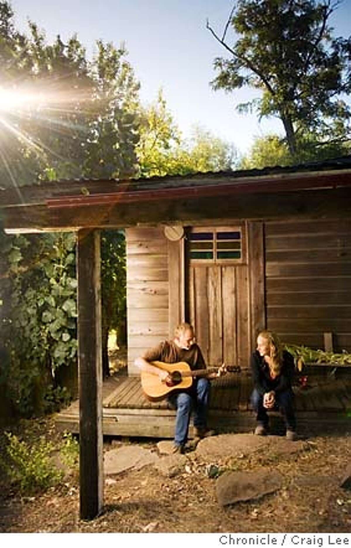 OTHERNAPA07_311_cl.jpg Story about Napa Valley wineries that have avoided the spotlight. Lore Olds and his daughter Mayacamus, owner of Sky Vineyards at the top of 2200 feet Mount Veeder. Photo of Lore (left) and Mayacamus (right), sitting and playing guitar on his front porch to the home he built in 1972 and where Mayacamus grew up. on 8/24/07 in Napa. photo by Craig Lee / The Chronicle Ran on: 09-02-2007 MANDATORY CREDIT FOR PHOTOG AND SF CHRONICLE/NO SALES-MAGS OUT